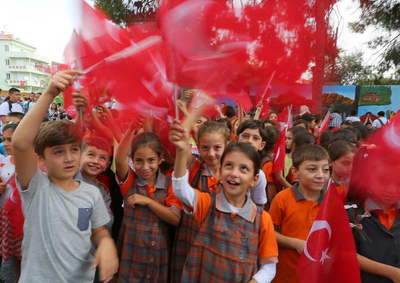 Students wave Turkish flags at a ceremony to mark the start of the school year in u0130zmir.