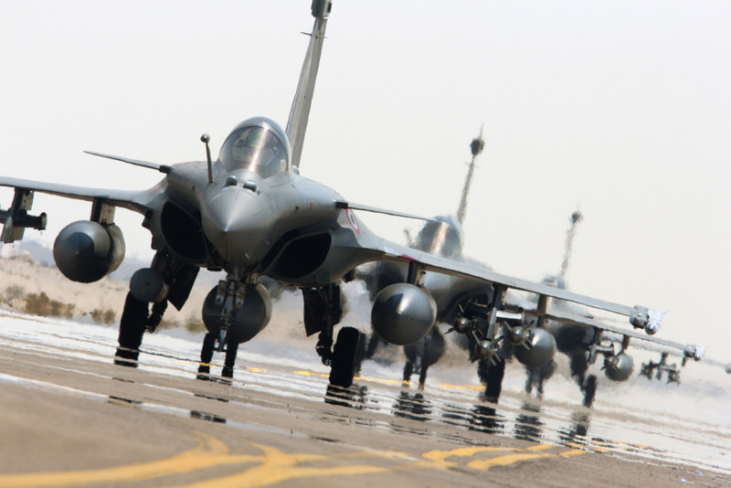 This photo released on Sept. 27, 2015, by the French Army Communications Audiovisual Office (ECPAD) shows French army Rafale fighter jets on the tarmac of an undisclosed air base in support of the US-led coalition against ISIS.