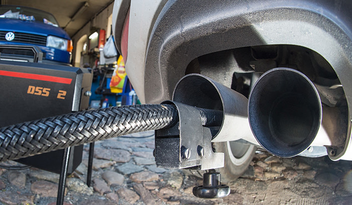A measuring hose for emissions inspections in diesel engines sticks in the exhaust tube of a Volkswagen (AFP Photo)