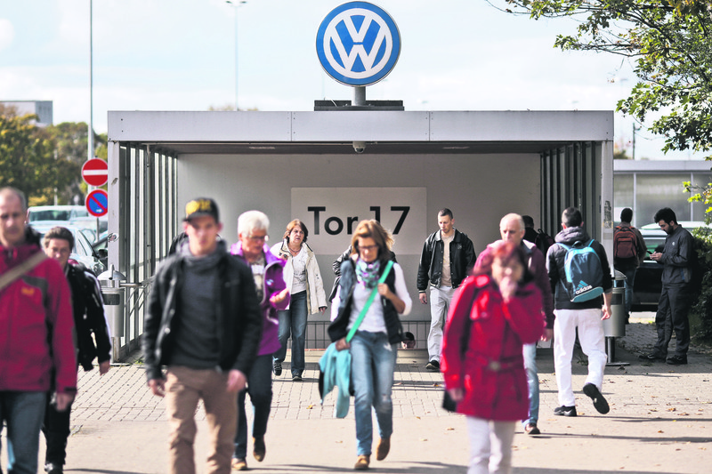 People leave the Volkswagen factory at Gate 17 in Wolfsburg, Germany. Thanks to Volkswagen, Wolfsburg boomed in West Germany's post-war rebirth, and today the town and the company are inseparable.