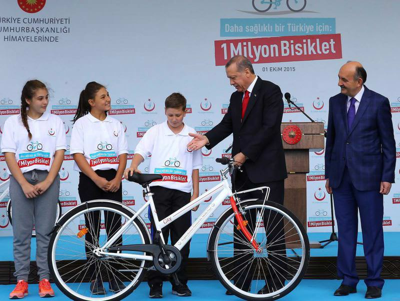 President Recep Tayyip Erdou011fan handed out bicycles to students in Ankara on Thursday during a Health Ministry program to promote bicycle riding to combat obesity.