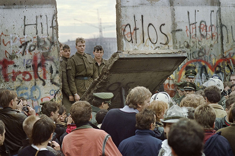 A Photo showing border guards demolishing a section of the wall separating East and West Germany in November 1989 (AFP Photo)