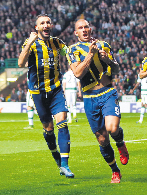 Fenerbahu00e7e's Fernandao celebrates scoring their second goal with Mehmet Topal.