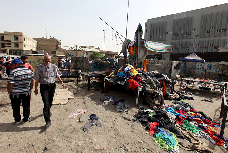 At least 12 people were killed when three bombs went off in mainly Shi'ite neighborhoods in central Baghdad on Thursday, security and medical sources said (Reuters Photo)