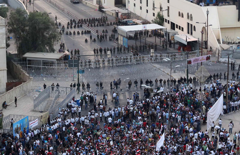 Iraqi security forces close a bridge leading to the heavily guarded Green Zone during a demonstration against corruption in Tahrir Square in Baghdad, Iraq, Friday, Oct. 2, 2015. (AP Photo)