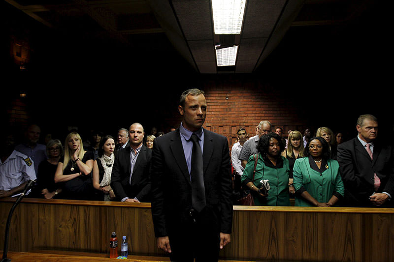 ,Blade Runner, Oscar Pistorius awaits the start of court proceedings in the Pretoria Magistrates court in this February 19, 2013 file photo (Reuters).