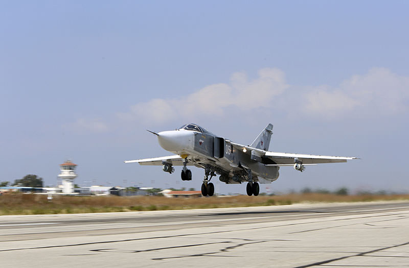 In this photo taken on Saturday, Oct. 3, 2015, Russian SU-24M jet fighter armed with laser guided bombs takes off from a runaway at Hmeimim airbase in Syria (AP Photo).