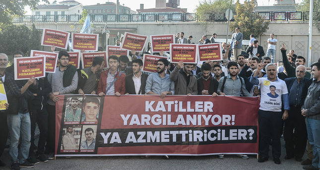 Murderers are being tried, how about instigators? the banner held by activists reads in front of Ankara Courthouse on October 5. (AA Photo)