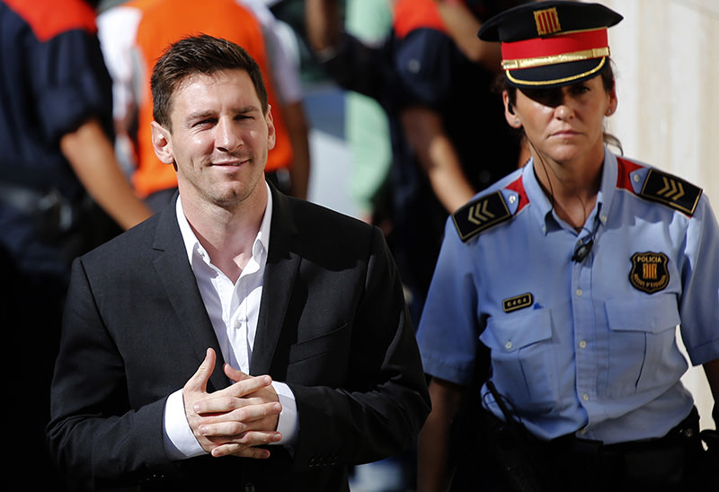 Barcelona F.C. star Lionel Messi, left, arrives at a court to answer questions in a tax fraud case in Gava, near Barcelona, Spain (AP Photo)