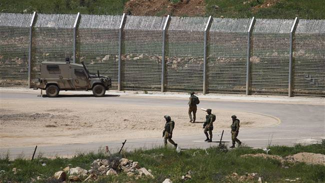 Israeli forces patrol along the fence in the occupied Golan Heights on the border with Syria, on April 27, 2015. (AFP Photo)