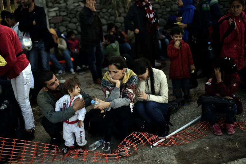 Refugees and migrants rest after arriving on the Greek island of Lesbos after crossing the Aegean Sea