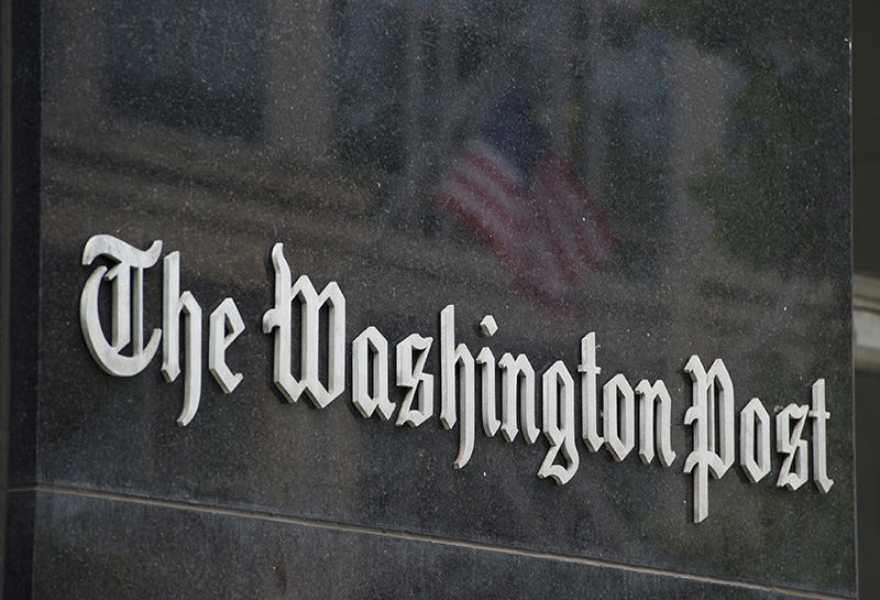 This August 6, 2013 file photo shows a sign outside of the Washington Post Building in Washington, DC (AFP Photo)