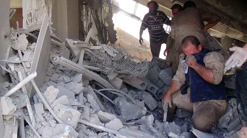 This Wednesday, Sept. 30, 2015 file image released by the Syria Civil Defence, a volunteer search and rescue group, shows the aftermath of an airstrike in Talbiseh, Homs province (AP Photo)