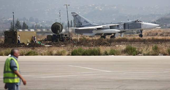 A handout picture dated 03 October 2015 made available on the official website of the Russian Defence Ministry on 06 October 2015 shows Russian SU-24 M bomber taking off from the Syrian Hmeymim airbase, outside Latakia, Syria. (EPA Photo)