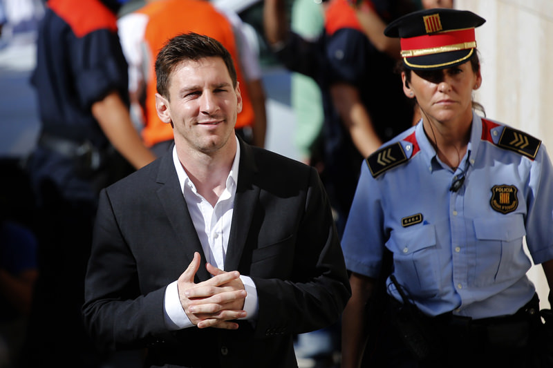 In this Sept. 27, 2013 file photo, FC Barcelona star Lionel Messi, left, arrives at a court to answer questions in a tax fraud case in Gava, near Barcelona, Spain. (AP Photo)