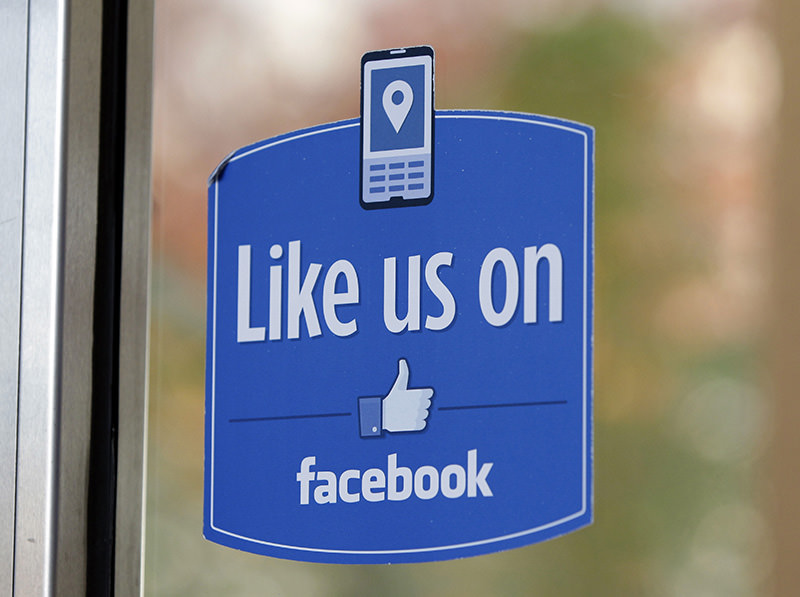 In this Dec. 13, 2011 file photo, a sign with Facebook's ,Like, logo is posted at Facebook headquarters near the office for the company's User Operations Safety Team in Menlo Park, Calif. (AP photo)