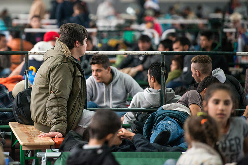 Refugees wait at a registration facility for asylum seekers of the German Federal Police (EPA Photo)