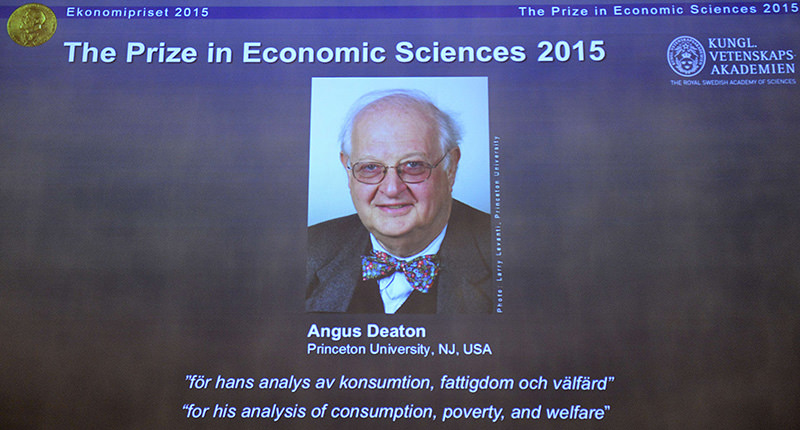 A portrait of US-British winner of the 2015 Nobel Economics Prize Angus Deaton is displayed on a giant screen during a press conference on October 12, 2015 in Stockholm. (AFP photo)