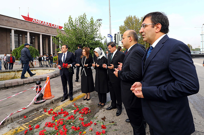 A handout picture provided by the Turkish Prime Minister's Press Office on 13 October 2015 of PM Davutou011flu (3-R), his wife Sare (4-R) and others praying for the victims (EPA photo).