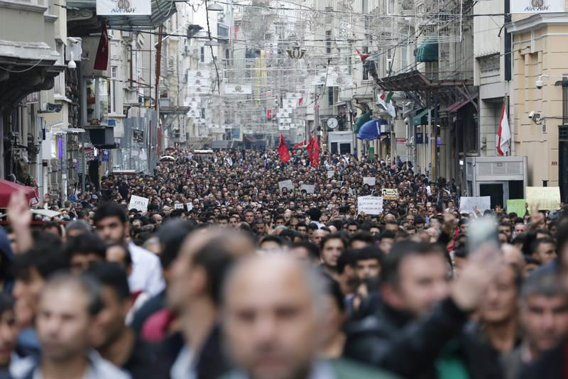 Protestors shout slogans against violence as they gather in reaction to the terrorist attacks in Ankara.