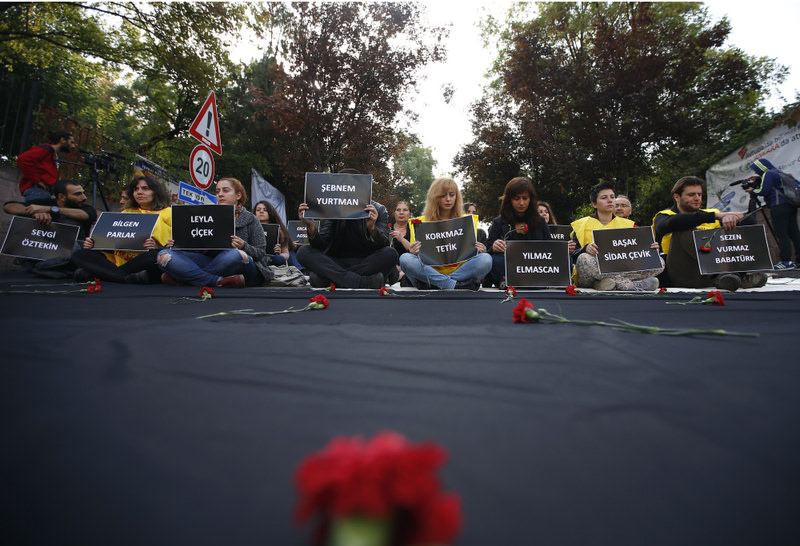 Ankara University students hold placards with the names of those killed in Saturday's deadly explosions during a sit-in protest in the Turkish capital.
