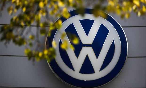 In this Oct. 5, 2015 file photo the VW sign of Germany's car company Volkswagen is displayed at the building of a company's retailer in, Berlin, Germany. (AP Photo)