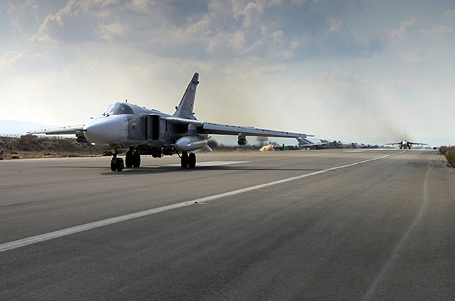 A Russian SU-24M jet fighter prepares to take off from an airbase Hmeimim in Syria. (AP Photo)