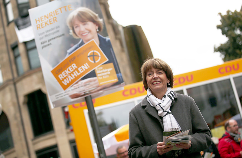 Henriette Reker (Left), a prominent candidate for the mayoral election in Cologne, campaigning in Cologne, western Germany. (AFP Photo)