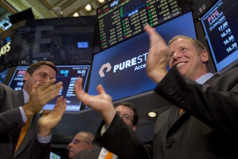Pure Storage Inc. CEO Scott Dietzen (R) celebrates his company's IPO on the floor of the New York Stock Exchange Oct. 7, 2015.