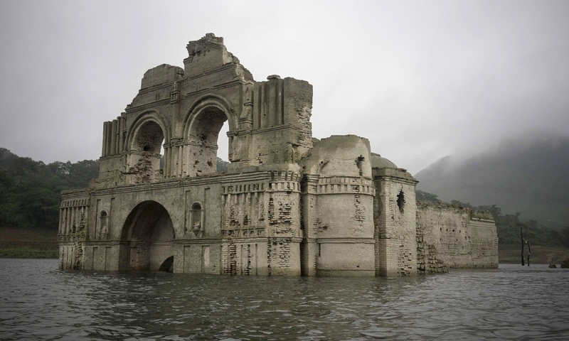 The remains of a mid-16th century church known as the Temple of Santiago, as well as the Temple of Quechula, is visible from the surface of the Grijalva River. (AP Photo)