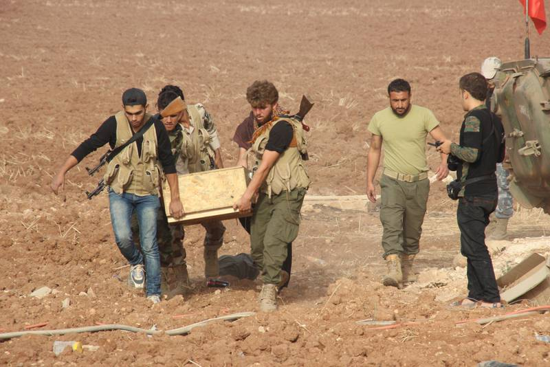 A group of Syrian Turkmen fighters are seen at the Havar Kilis region of Azaz, Syria.