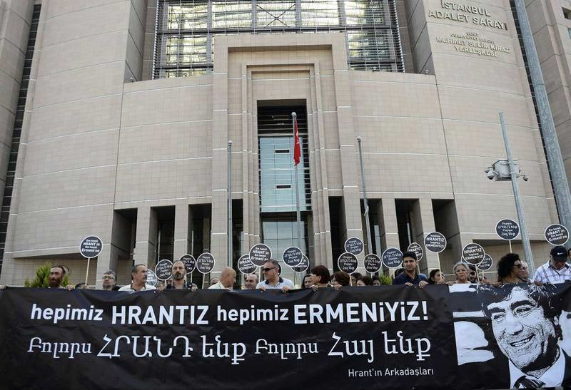 Activists holding a banner with a photo of Dink and a slogan reading ,We are all Hrant, we are all Armenians, outside an Istanbul courthouse where perpetrators of his murder were tried on Sept. 3.