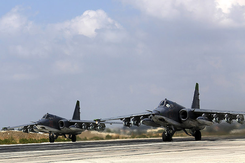 Two Russian SU-25 strike fighters taking off from the Syrian Hmeymim airbase, outside Latakia, Syria (EPA photo).