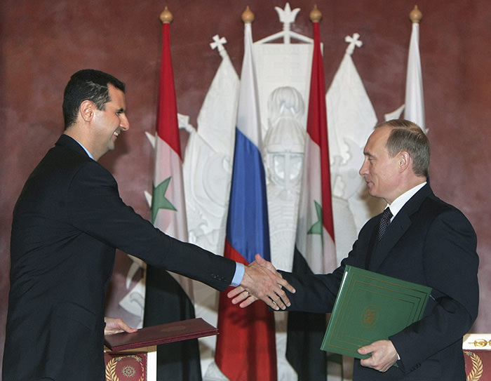 Jan. 25, 2005 file photo, Syrian President Bashar Assad, left, and Russian President Vladimir Putin shake hands during a signing ceremony in the Kremlin, Moscow (AP Photo)
