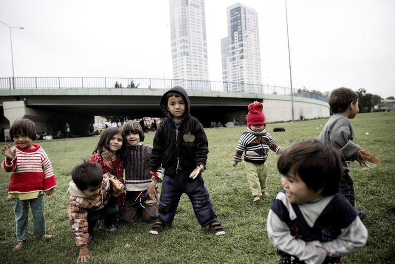 Afghan children play near an overpass where their families stay. Activists have called on authorities to help refugees.