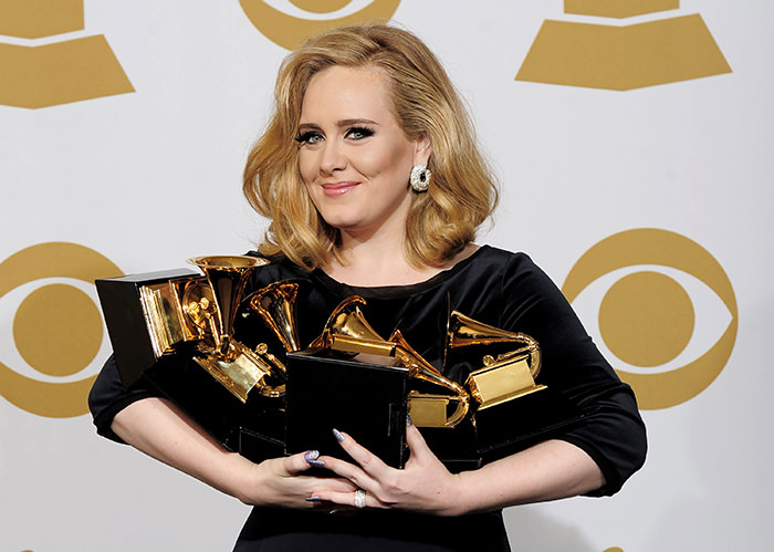 Adele poses backstage with her six awards at the 54th annual Grammy Awards in Los Angeles (AP Photo)