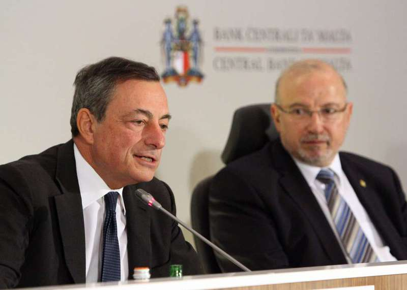 ECB head Draghi (L) speaks during a press conference following the Governing Council Meeting yesterday in Malta.