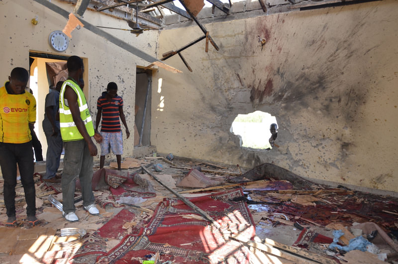 People inspect a damaged mosque following an explosion in Maiduguri, Nigeria, Friday, Oct. 23, 2015. (AP Photo)