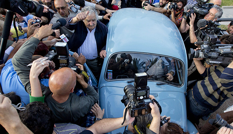 Uruguay's President Jose Mujica, center, leaves after casting his vote during general elections in Montevideo, Uruguay Sunday, Oct. 26, 2014 (AP Photo)