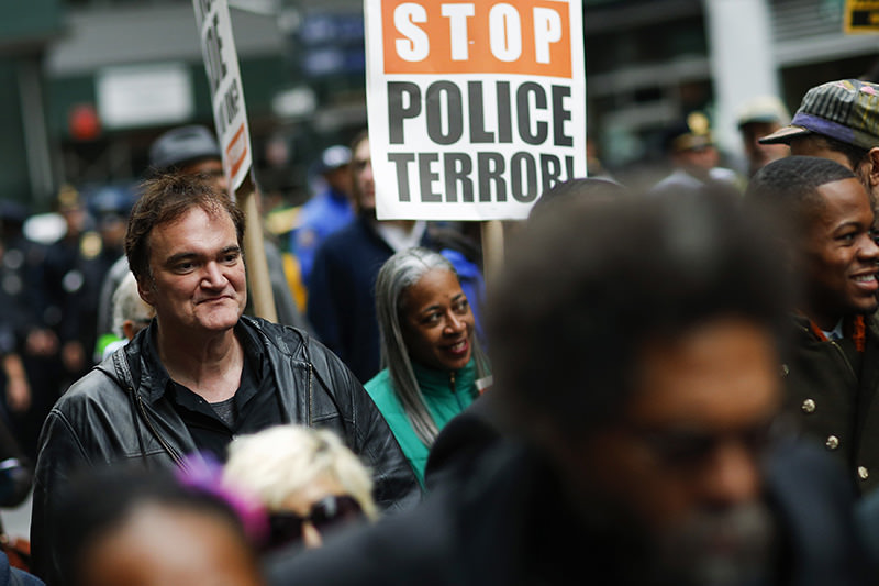 US film director Quentin Tarantino (L) takes part in a march against police brutality called ,Rise up October, on October 24, 2015, in New York (AFP Photo)