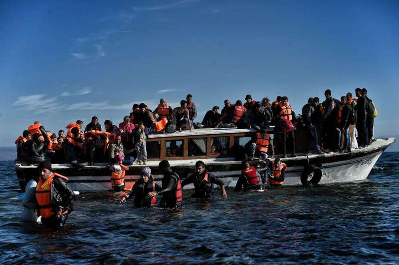 A group of refugees arrive on the Greek island of Lesbos after crossing the Aegean Sea from Turkey on Monday.