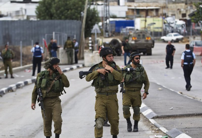 Israeli soldiers at the scene of a stabbing near the West Bank town of Hebron.