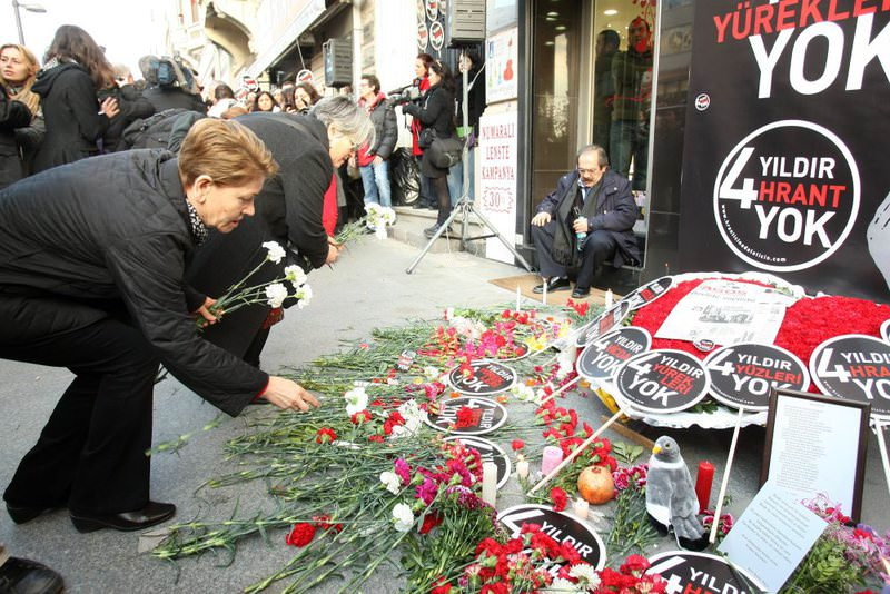 People leave flowers outside the offices of Agos newspaper where Hrant Dink was killed in 2007. Dink's family had long called for an investigation into the police's role in the murder.