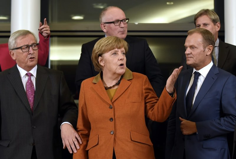 EU Commission President Juncker (L), German Chancellor Merkel (C) and European Council President Tusk (R) pose for a picture during the EU-Balkans mini-summit at EU headquarters in Brussels on Sunday.