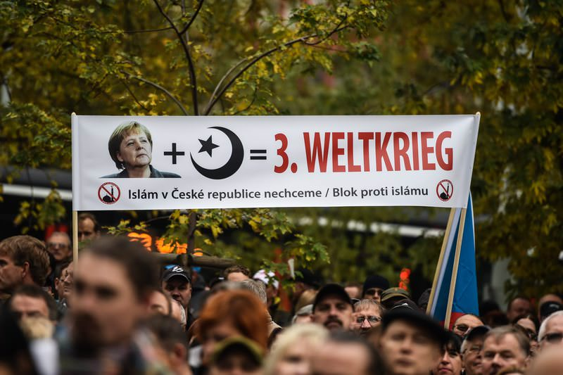 Protesters hold a banner reading in German: 'Merkel   Islam = 3rd World War' during an anti-Islam rally in Prague, Czech Republic, 28 October 2015. (EPA Photo)