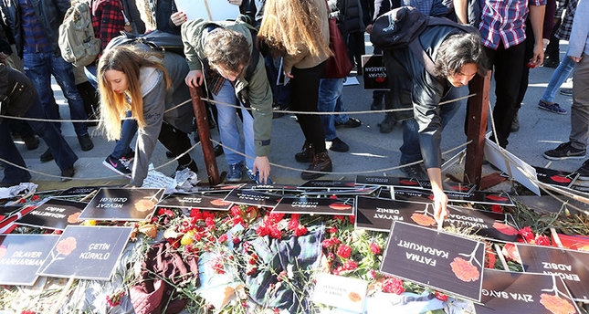 Members of youth organizations place posters with the names of victims of the double suicide bombing (AFP photo)
