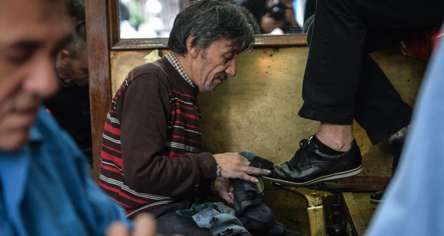 Shoeshine parlors endeavor to adapt to the changing world