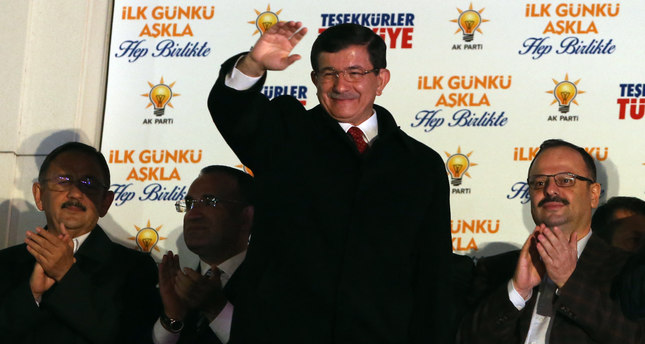 Prime Minister Ahmet Davutoğlu salutes supporters gathered outside AK Party headquarters in Ankara, Turkey, Sunday, Nov. 1, 2015.  AP Photo