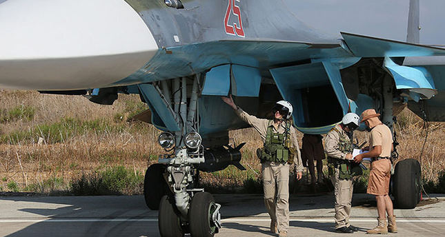 Russian pilots of SU-34 bomber checking their plane before the flight at the Syrian Hmeymim airbase, outside Latakia, Syria (EPA photo)