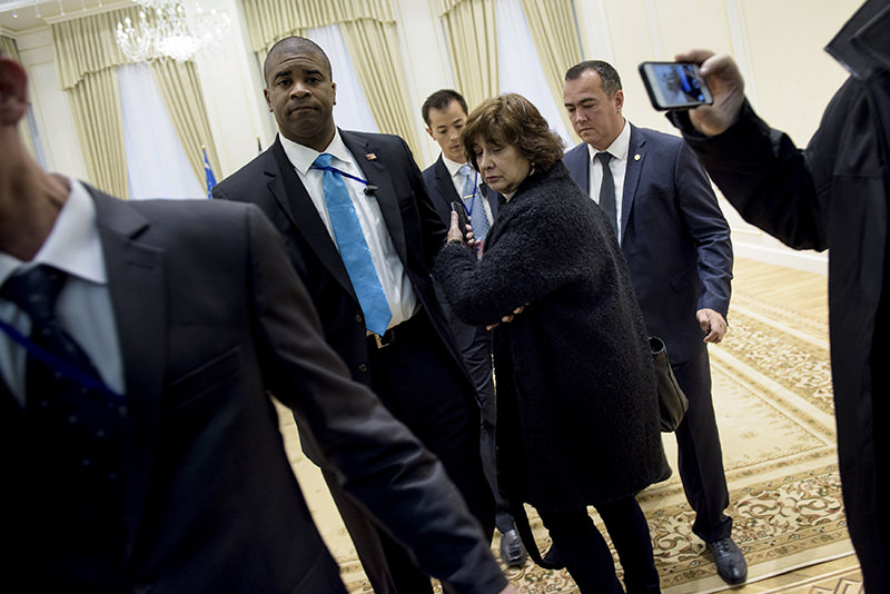 A US press pool reporter is escorted out after asking a question to Uzbek President Islam Karimov (not pictured) during a photo opportunity before a meeting with US Secretary of State John Kerry (Reuters Photo)